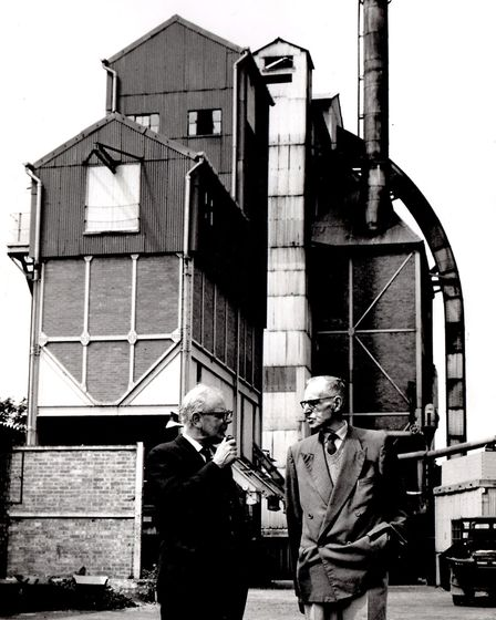 Two men pause for a mardle outside Gorleston gas works on Southtown Road.