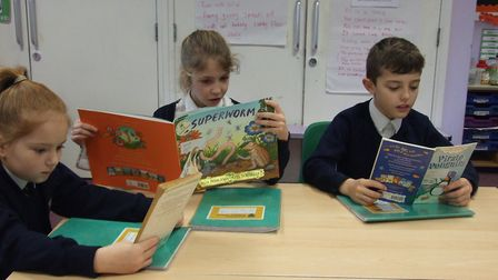 Year 4 pupils enjoying their favourite books in Southtown Primary School's reading café on World Boo