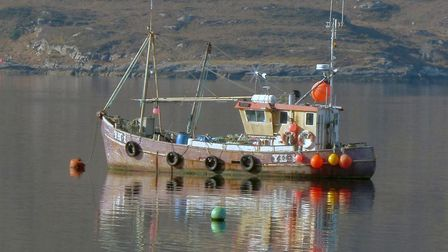 Our Seafarer, a fishing boat bearing the Yarmouth registration YH1, in calm waters in Scotland where