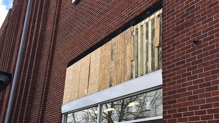 The hole in the wall has been boarded up with cardboard. Picture: Joseph Norton