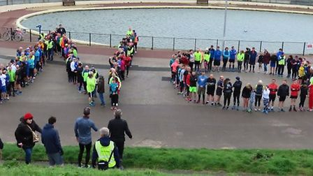 Runners took a break to spell out their opposition to a trio of kiosks on Gorleston's lower prom Pic