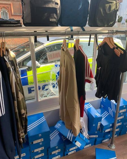 A police investigation is underway after thieves threw a brick through a shop window and stole Adida