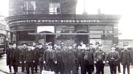 Lifeboatmen outside the Ship Inn before their outing perhaps early last century.