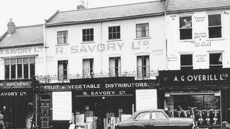 Fruit and vegetable wholesaler Savory next to Overill's modernised cycle shop in 1962. Picture: Coli