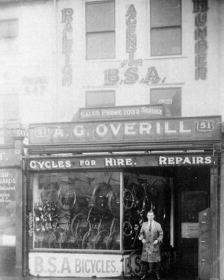 The proprietor outside his Overill's bicycle shop on Great Yarmouth Market Place in 1946. Picture: C