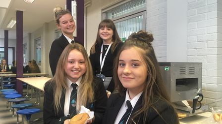 Teaching assistant at Caister Academy Melissa Scott (middle) with pupils at the school's breakfast c