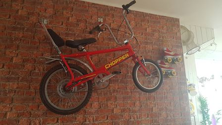A chopper bike on the wall at Darling Darlings Cat Cafe is part of the quirky, vintage decor Picture