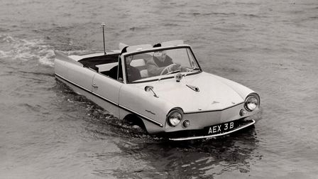 Deep puddle? No, the river in Yarmouth in 1964 being crossed by one of the aqua-cars being developed
