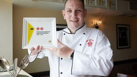 Daniel Lawrence with the 2 AA rosettes plate award to Cafe Cru for its a la carte menu Picture: Keir