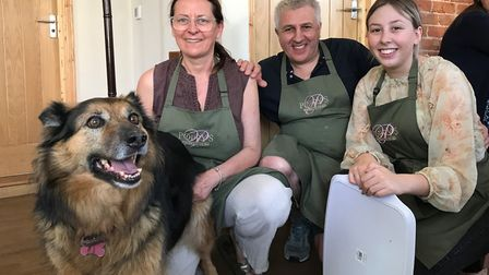 From left to right: Poppy (dog), Jeanne, Gino and Becky Farace, owners of Poppy's Tearoom in Wintert