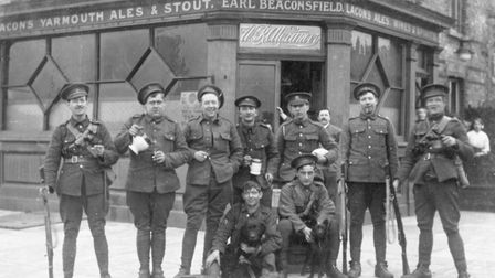 Off duty soldiers of the Essex Regiment celebrating outside the Earl Beaconsfield public house on No