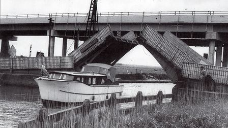 Over and under...the new Haddiscoe Bridge towers over the old hand-operated twin-leaf bascule bridge