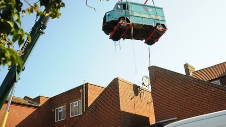 The Citroen H burger van is lifted high over the roof to be placed inside Peggotty's pub at Great Ya