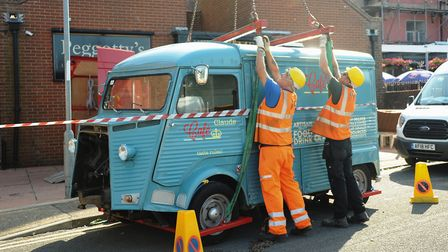 The Citroen H burger van is prepared to be lifted inside Peggotty's pub at Great Yarmouth. Picture: