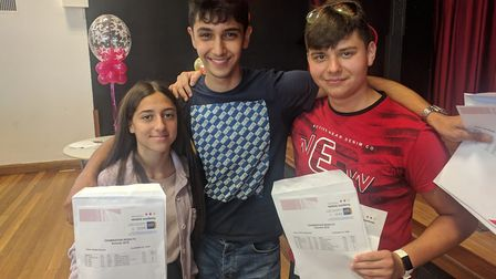 Bobbi Docwra, Aref Shafiei and Raul Hasmasan, all 16, after collecting their GCSE results at Ormisto