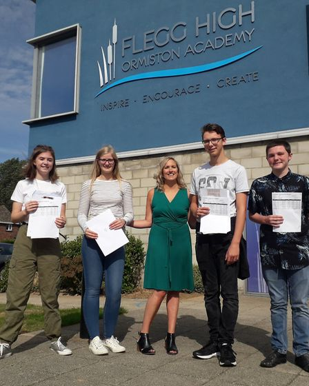 Esme Siddall, Rose Turner, Franklin Woods and Jake Bowler after collecting their GCSE results at Fle