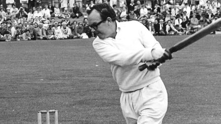 Eric Morecambe plays a shot during a charity match between a local XI and showbiz members from Yarmo