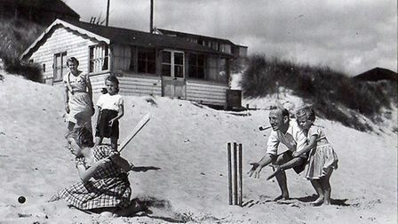 "A grass-free ""pitch"" did not deter the Tinkler family, from Norwich, enjoying beach cricket at Hemsb"