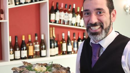 Goncalo Simoes, head waiter at Strollers, the seafood restaurant, serves up a platter of Orford oyst