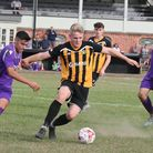 Great Yarmouth Town substitute Billy Wenn holds off a challenge during the FA Vase defeat at the han