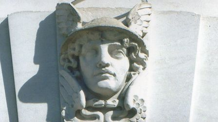 Mercury, Messenger of the Gods, sculpted above the doorway.