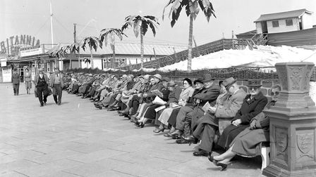 Not a mobile telephone in sight! Elderly visitors outside the Britannia Pier in Great Yarmouth in 19