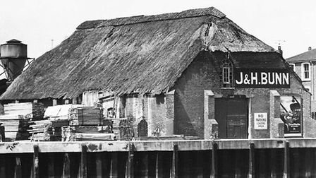 The thatched former ice-house and grain store of J & H Bunn on the quayside next to Yarmouth's Haven