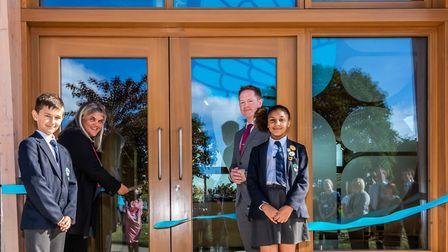 Pupil Tommy Brown, Creative Education Trust board member, Sasha Bhavan who is cutting the ribbon, He