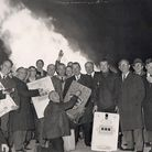 Money to burn: amusement arcade owners protesting against a tax celebrate in front of the flaming bo