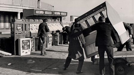 Slot machines being carried on to Great Yarmouth beach in 1969 to create a Guy Fawkes Night bonfire
