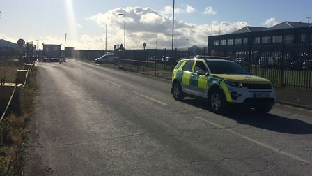 An emergency vehicle leaving the scene of an 'industrial incident' at Great Yarmouth's outer harbour