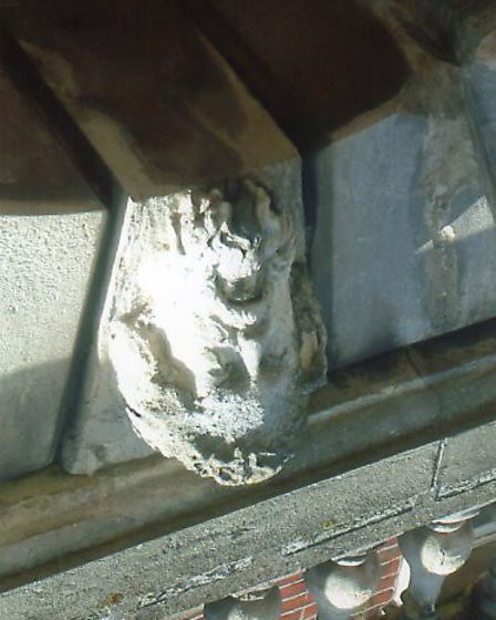 The sculpted stone head above the closed Barclays Bank doorway on Hall Quay in Yarmouth.