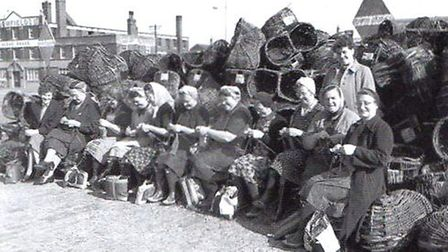 Keeping their nimble fingers busy: Scottish fisher-lassies enjoy knitting while awaiting the next ca