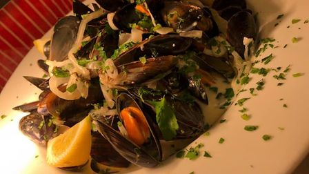Mussels in garlic, parsley and a white wine cream sauce is among dishes winning praise at Garrod's B