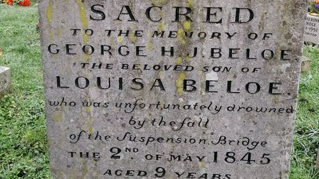 The tombstone dedicated to George Beloe, a 9-year-old child who died in the suspension bridge disast