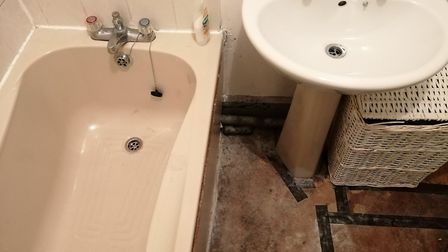 """He claims the floorboards in his bathroom have rotted away due to damp, and smell """"horrific"""". PHOTO:"""