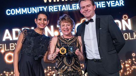 Judith Brown accepts a Community Retailer of the Year award at the annual Federation of Independent