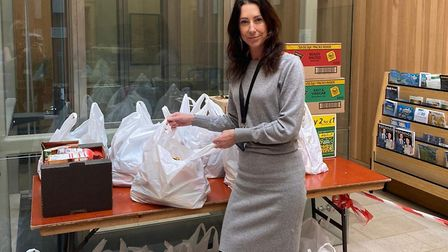 Shelia Oxtoby, the council's CEO, helping organise supplies for community foodbanks. PHOTO: GY Borou