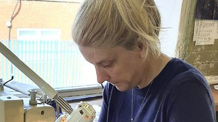 Yarmouth Stores factory manager Sharon Bowles making cloth face masks for care homes Picture: Beth S