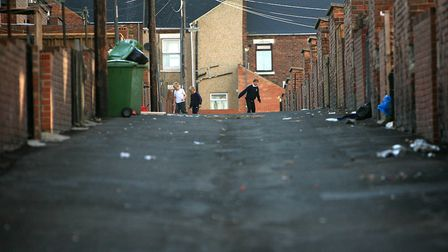 Children play in the back alley of their homes in Peterlee
