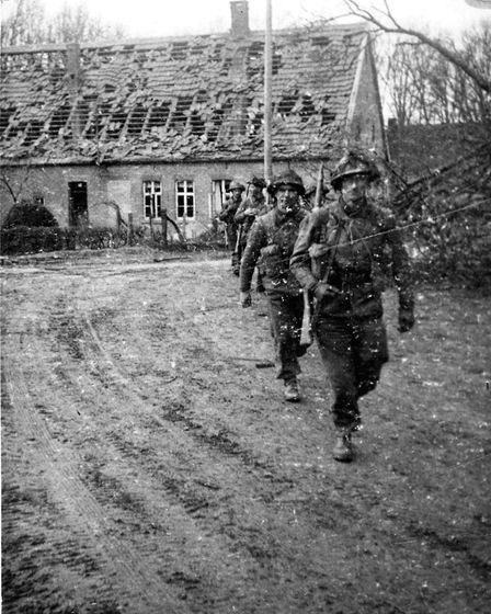 The road to VE Day: men of the 1st Royal Norfolks on the advance during what would prove a hard-foug