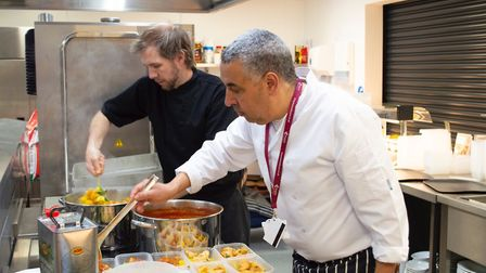 Ali Guenaoui (Right), Simon Wainwright (Left) preparing food for NHS workers Picture: Kingsley/Gord