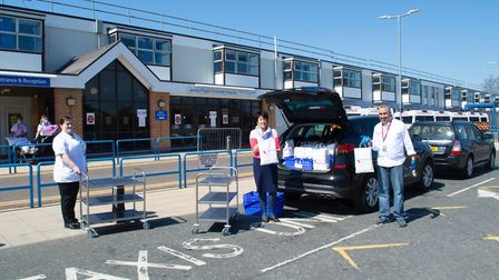 Handing over the food at The James Paget Hospital Picture: Kingsley/Gordon Powles