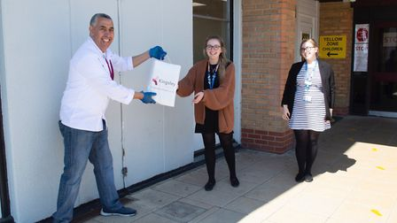 Ali Guenaoui handing the food to James Paget Hospital staff. Picture: Kingsley/Gordon Powles