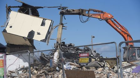 Part of the building falls as machinery is at work demolishing the Marina Centre at Great Yarmouth.