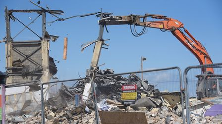 A bit of the building support falls as machinery is at work demolishing the Marina Centre at Great Y