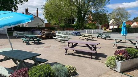 Tables set out to host takeaway diners waiting for their food and drink at The Lion, in Thurne Pictu
