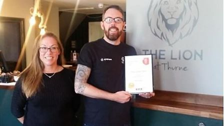 Ricky Malt at the award-winning Lion pub with general manager Rachel Parr Picture: Ricky Malt