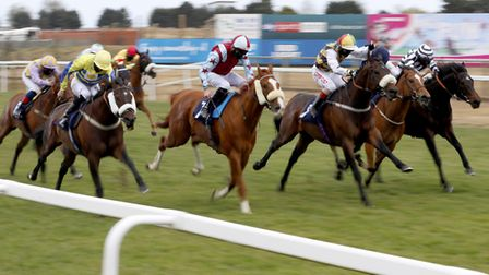 Ginger Max,ridden by Franny Norton (third right), on their way to winning the Betway Live Casino Han