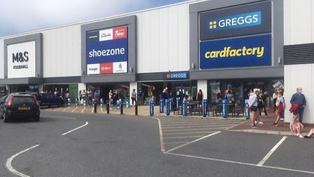 Hundreds of people waiting in line for entry into Sports Direct on June 15. The chain was offering 5